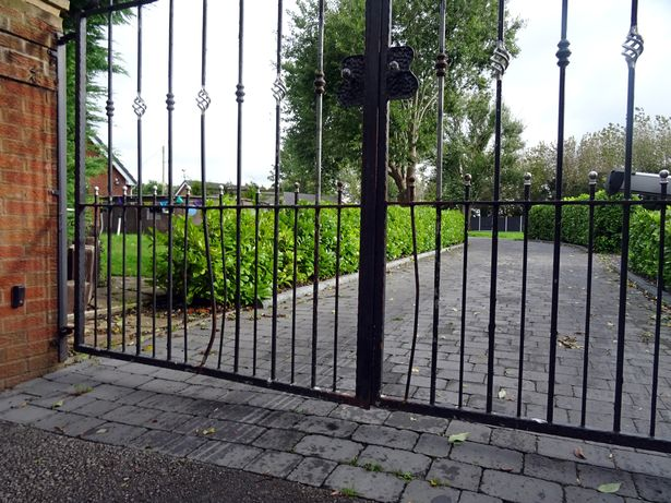 The gates where a woman was bitten by two French Bulldogs at John Gizzi's home in St Asaph