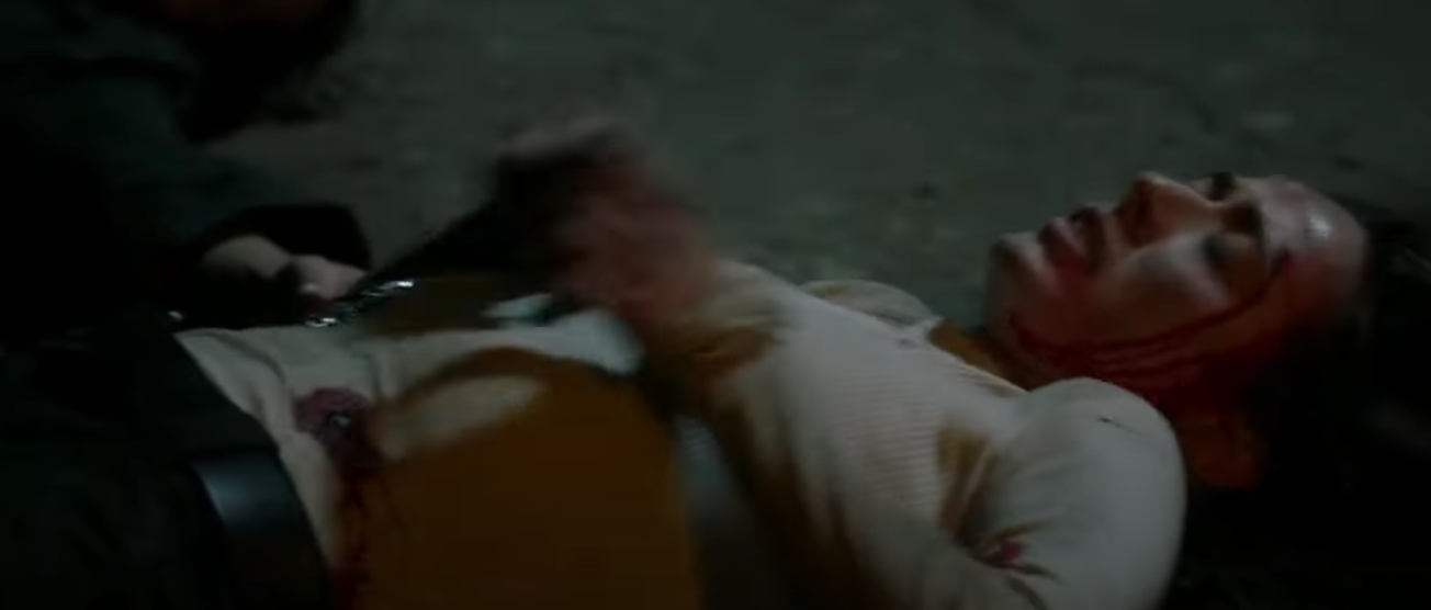 Burgess lying on the floor after being shot by Roy.